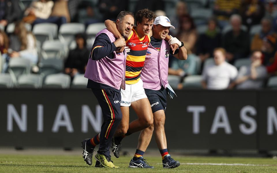 Will Hamill carried off injured during the 2021 AFL Round 06 match between the Hawthorn Hawks and the Adelaide Crows.