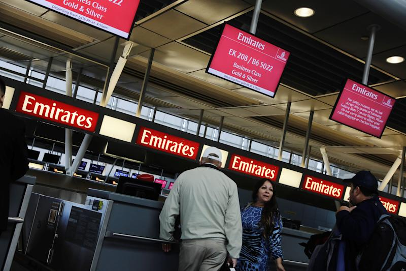 Travelers wait at an Emirates Airlines ticket desk at JFK International Airport in New York, U.S., March 21, 2017.  REUTERS/Lucas Jackson