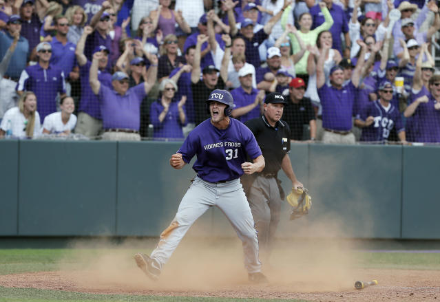 TCU's Jerrick Suiter celebrates scoring on teammate Kyle Bacak's bunt for an RBI, on what would be the game winning run, during the ninth inning of an NCAA college baseball tournament super regional game against Pepperdine in Fort Worth, Texas, Monday, June 9, 2014. TCU won 6-5. (AP Photo/Brandon Wade)