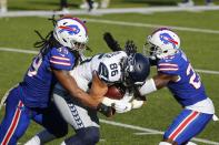 Buffalo Bills' Tremaine Edmunds (49) and Tre'Davious White (27) tackle Seattle Seahawks' Jacob Hollister (86) during the first half of an NFL football game Sunday, Nov. 8, 2020, in Orchard Park, N.Y. (AP Photo/Jeffrey T. Barnes)