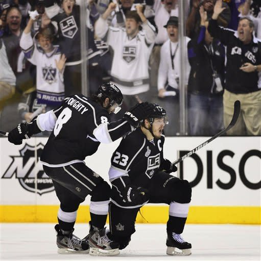 Los Angeles Kings right wing Dustin Brown (23) and Los Angeles Kings defenseman Drew Doughty (8) celebrate after Brown scored his second goal of the first period against the New Jersey Devils during Game 6 of the NHL hockey Stanley Cup finals, Monday, June 11, 2012, in Los Angeles. (AP Photo/Mark J. Terrill)