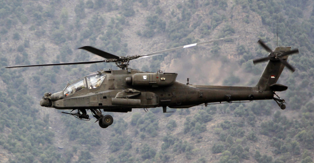 The Boeing AH-64 Apache is an American twin-turboshaft attack helicopter with a tailwheel-type landing gear arrangement and a tandem cockpit for a crew of two.