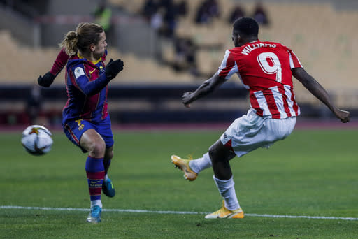 Athletic Bilbao's Inaki Williams, right, scores his team third goal during the Spanish Supercopa final soccer match between FC Barcelona and Athletic Bilbao at La Cartuja stadium in Seville, Spain, Sunday, Jan. 17, 2021. (AP Photo/Miguel Morenatti)