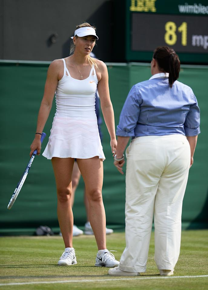 LONDON, ENGLAND - JUNE 26: Maria Sharapova of Russia talks with the chair umpire during her Ladies' Singles second round match against Michelle Larcher de Brito of Portugal on day three of the Wimbledon Lawn Tennis Championships at the All England Lawn Tennis and Croquet Club on June 26, 2013 in London, England. (Photo by Dennis Grombkowski/Getty Images)