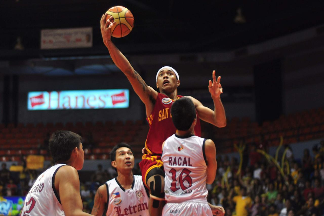Calvin Abueva (7) of SSCR attacks the basket during the NCAA Final Four match up between The San Sebastian Stags and The Letran Knights, held at the San Juan Arena on 15 October 2012. (George Calvelo/NPPA Images)