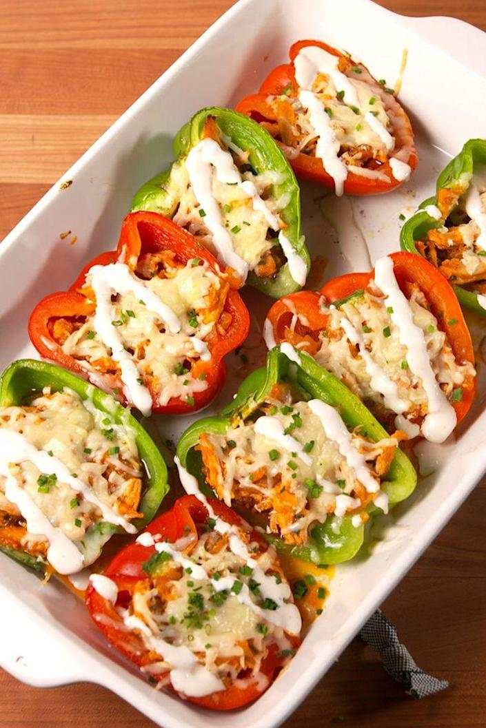 "<p>Spice up your stuffed pepper game!</p><p>Get the recipe from <a href=""https://www.delish.com/cooking/recipe-ideas/recipes/a51994/buffalo-chicken-stuffed-peppers-recipe/"" rel=""nofollow noopener"" target=""_blank"" data-ylk=""slk:Delish"" class=""link rapid-noclick-resp"">Delish</a>.</p>"