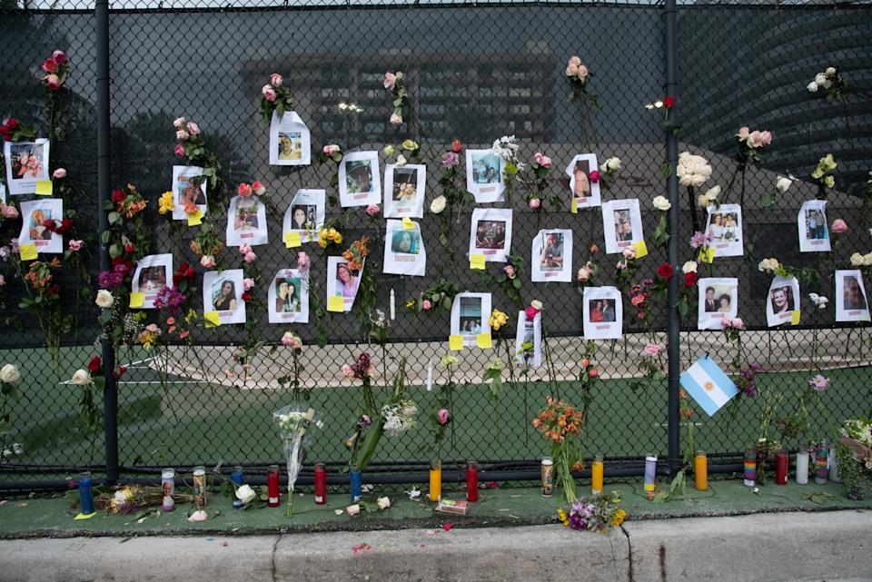 A makeshift memorial showing photos of people missing following the apartment building's collapse in Florida.