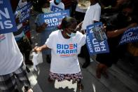 Supporters of Democratic U.S. presidential nominee Joe Biden attend a gathering as he campaigns in Miami