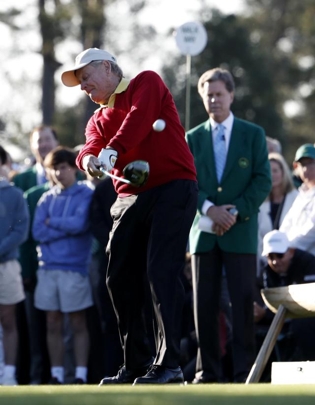 """Honorary starter Jack Nicklaus of the U.S. tees off while watched by Chairman, Augusta National Golf Club and the """"Masters"""" Tournament, Fred S. Ridley (R), during the ceremonial start before first round play in the 2018 Masters golf tournament at the Augusta National Golf Club in Augusta, Georgia, U.S. April 5, 2018. REUTERS/Jonathan Ernst"""