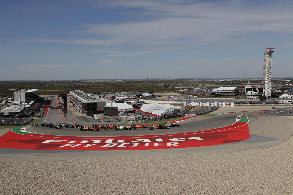 Mercedes driver Valtteri Bottas, of Finland, leads the field in the first turn at the start of the Formula One U.S. Grand Prix auto race at the Circuit of the Americas, Sunday, Nov. 3, 2019, in Austin, Texas. (AP Photo/Eric Gay)