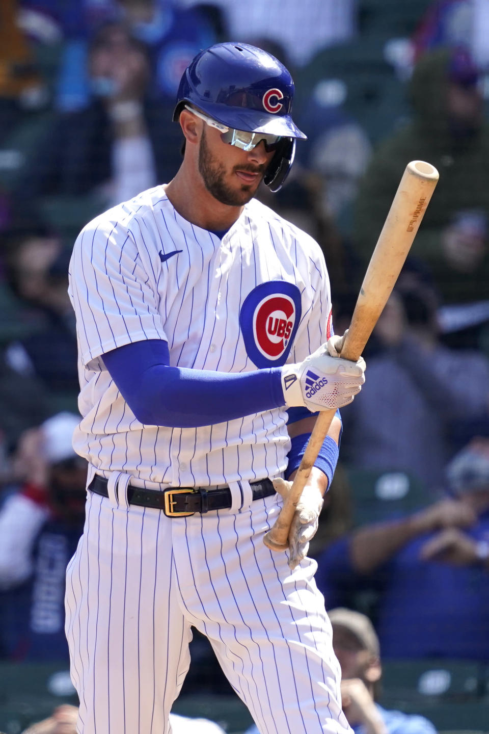 FILE - Chicago Cubs' Kris Bryant checks his bat during the first inning of a baseball game against the Pittsburgh Pirates in Chicago, in this April 3, 2021, file photo. Bryant's versatility, while producing offensive numbers that belong alongside his NL MVP season in 2016, is a big reason why Chicago is on top of the NL Central once again, helping the Cubs go on a 21-9 run while dealing with a rash of injuries. (AP Photo/Nam Y. Huh, File)