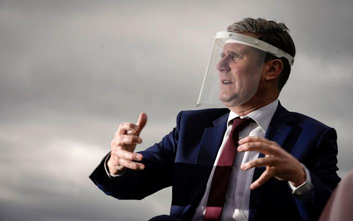 Labour Party leader, Sir Keir Starmer, wears a face visor during a visit in Nottingham