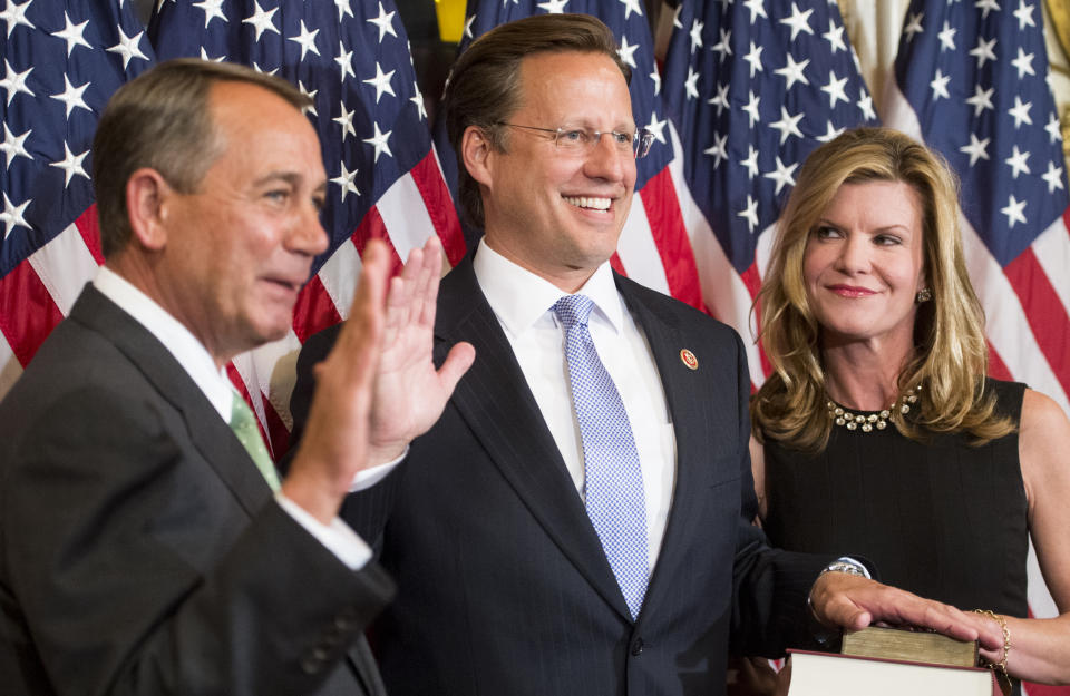 Rep.-elect Dave Brat, R-Va., raises his right hand as his wife Laura looks on during the ceremonial swearing-in photo-op with Speaker of the House John Boehner in the Capitol on Wednesday, Nov. 12, 2014. (Bill Clark/CQ Roll Call via Getty Images)