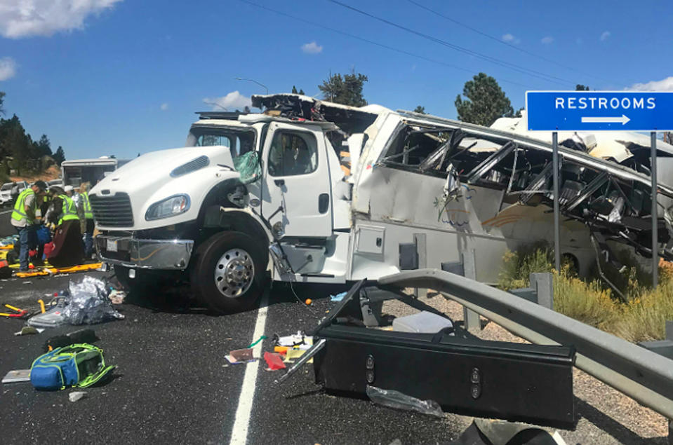 FILE - This photo released by the Garfield County Sheriff's Office shows a tour bus that crashed near Bryce Canyon National Park in southern Utah on Sept. 20, 2019. The tour bus that crashed and killed four Chinese tourists near a national park in Utah in 2019 had problems earlier that day with the engine not starting, according to a new documents released Wednesday, March 31, 2021, by U.S. authorities investigating the incident. (Sheriff Danny Perkins/Garfield County Sheriff's Office via AP, File)
