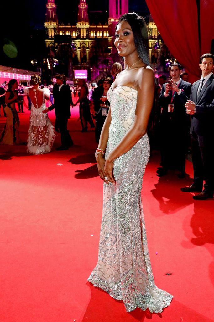 Naomi Campbell wears a silver dress at the Life Ball