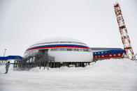 """A soldier stands at a central atrium called the """"Arctic Trefoil"""" on the Alexandra Land island near Nagurskoye, Russia, Monday, May 17, 2021. Once a desolate home mostly to polar bears, Russia's northernmost military outpost is bristling with missiles and radar and its extended runway can handle all types of aircraft, including nuclear-capable strategic bombers, projecting Moscow's power and influence across the Arctic amid intensifying international competition for the region's vast resources. (AP Photo/Alexander Zemlianichenko)"""