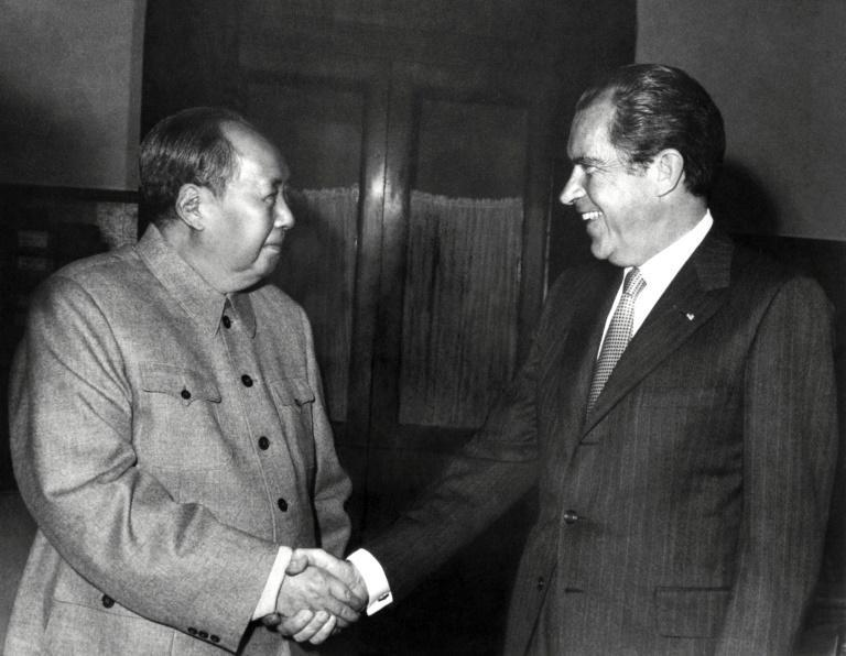 Chinese leader Mao Zedong and President Richard Nixon hold a historic meeting on February 22, 1972
