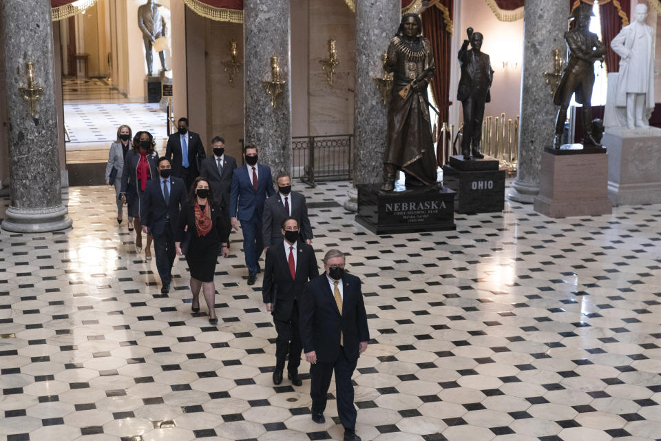 Acting Sergeant at Arms Timothy Blodgett, bottom right, leads Rep. Jamie Raskin, D-Md., the lead Democratic House impeachment manager, Rep. David Cicilline, D-R.I., Rep. Diana DeGette, D-Colo., Rep. Joaquin Castro, D-Texas, Rep. Eric Swalwell, D-Calif., Rep. Ted Lieu, D-Calif., Delegate Stacey Plaskett, D-V.I., Rep. Madeleine Dean, D-Pa., and Rep. Joe Neguse, D-Colo., through Statuary Hall to the Senate for the second impeachment trial of former President Donald Trump, Tuesday, Feb. 9, 2021, in Washington. (AP Photo/Manuel Balce Ceneta)