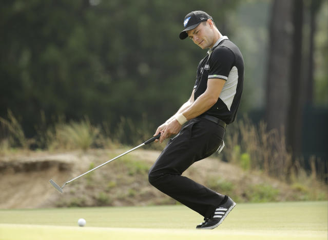 Martin Kaymer, of Germany, reacts to his missed birdie on the 17th hole during the second round of the U.S. Open golf tournament in Pinehurst, N.C., Friday, June 13, 2014. (AP Photo/Chuck Burton)