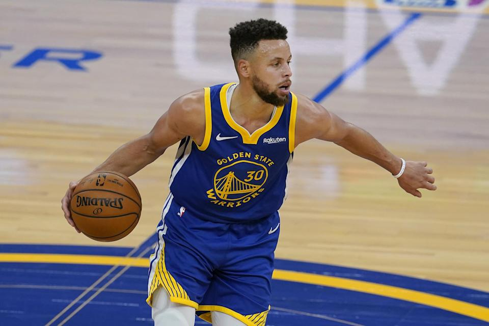 Golden State Warriors guard Stephen Curry dribbles the ball up the court against the Cleveland Cavaliers during the first half of an NBA basketball game in San Francisco, Monday, Feb. 15, 2021. (AP Photo/Jeff Chiu)