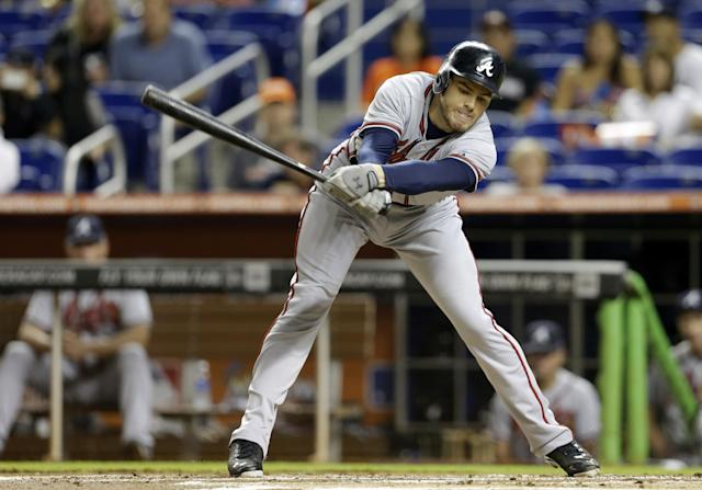 Atlanta Braves' Freddie Freeman strikes out in the first inning during a baseball game against the Miami Marlins, Wednesday, Sept. 11, 2013, in Miami. (AP Photo/Lynne Sladky)