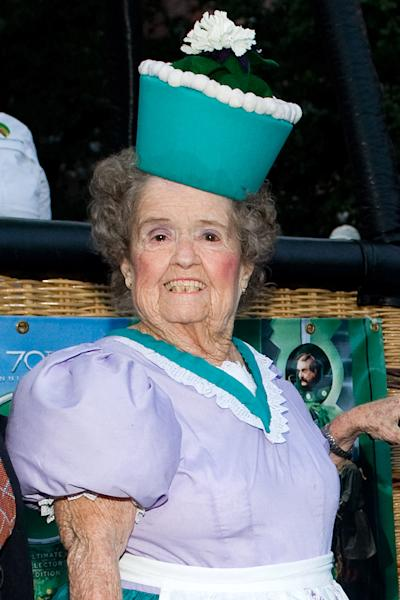 """FILE - In this Sept. 24, 2009 file photo, Margaret Pellegrini, a cast member who played a Munchkin named Sleepy Head in the original """"The Wizard of Oz"""" movie, attends the film's 70th Anniversary Emerald Gala at Tavern on the Green in New York. Pellegrini suffered a stroke Monday, Aug. 5, 2013 at her Glendale, Ariz., home and died Wednesday, Aug. 7, 2013 at a Phoenix-area hospital. She was 89. (AP Photo/Charles Sykes, File)"""