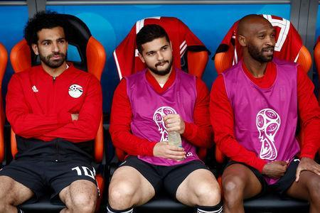 Soccer Football - World Cup - Group A - Egypt vs Uruguay - Ekaterinburg Arena, Yekaterinburg, Russia - June 15, 2018 Egypt's Mohamed Salah, Sam Morsy and Shikabala on the substitues bench before the match REUTERS/Damir Sagolj