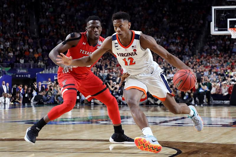 MINNEAPOLIS, MINNESOTA - APRIL 08: De'Andre Hunter #12 of the Virginia Cavaliers is defended by Norense Odiase #32 of the Texas Tech Red Raiders in the second half during the 2019 NCAA men's Final Four National Championship game at U.S. Bank Stadium on April 08, 2019 in Minneapolis, Minnesota. (Photo by Streeter Lecka/Getty Images)