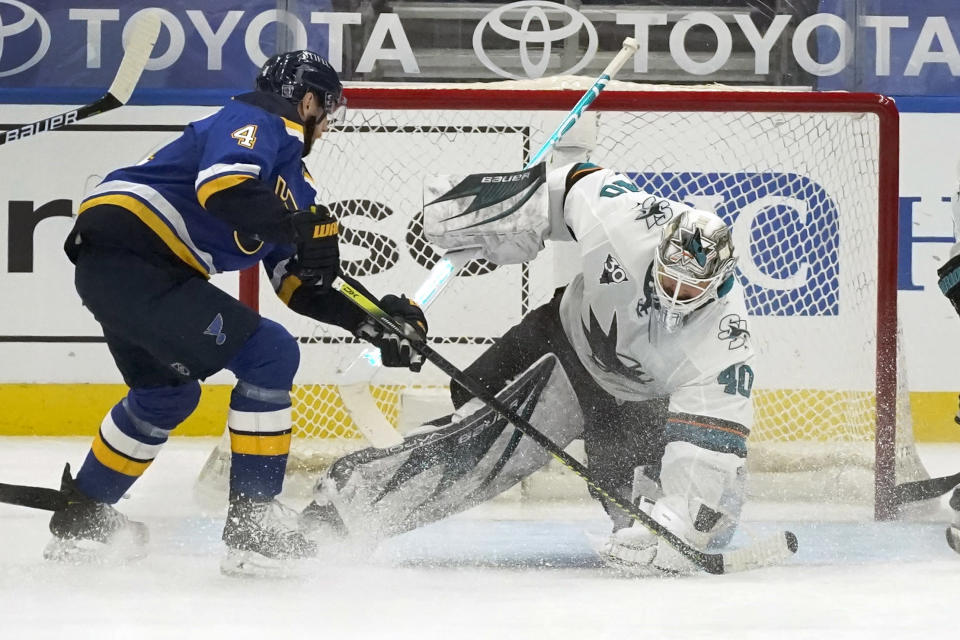 San Jose Sharks goaltender Devan Dubnyk (40) defends against St. Louis Blues' Carl Gunnarsson (4) during the first period of an NHL hockey game Monday, Jan. 18, 2021, in St. Louis. (AP Photo/Jeff Roberson)