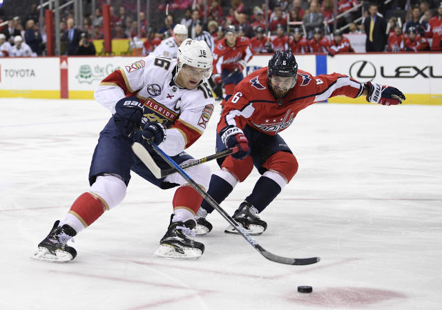 Florida Panthers center Aleksander Barkov (16), of Finland, chases the puck against Washington Capitals defenseman Michal Kempny (6), of the Czech Republic, during the first period of an NHL hockey game, Friday, Oct. 19, 2018, in Washington. (AP Photo/Nick Wass)