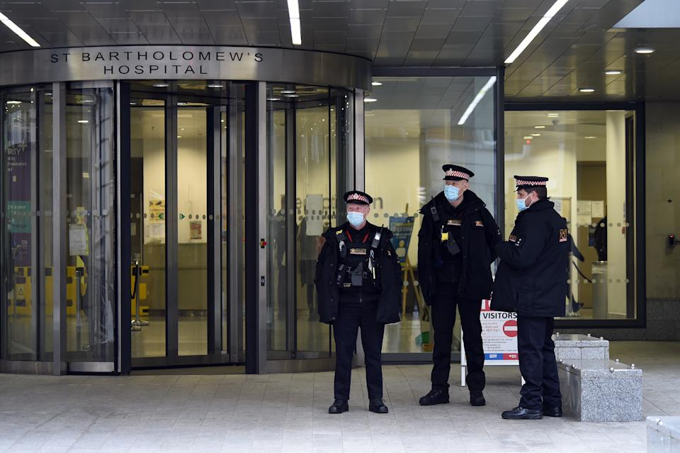 LONDON, ENGLAND - MARCH 03: City of London police outside the entrance to St Bartholomew's Hospital on March 03, 2021 in London, England. The Duke of Edinburgh was transferred on Monday from King Edward VII's Hospital to St Bartholomew's Hospital where doctors will continue to treat him for an infection, as well as undertake testing and observation for a pre-existing heart condition Buckingham Palace has said. (Photo by Kate Green/Getty Images)