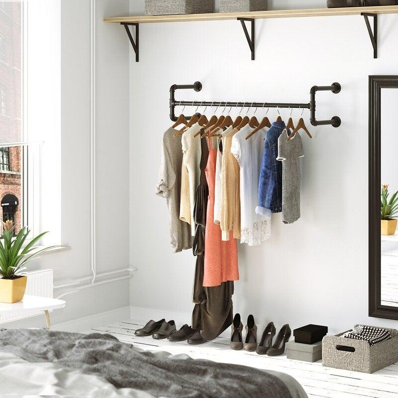 """<h2>26% Off Wall-Mounted Clothes Rack</h2><br><strong>117 reviews and 4.8 out of 5 stars</strong><br>""""Love my clothes rack. Frees up a lot of space for me in my room. Had to order 2 more can't wait to finish up.""""<br><br><em>Shop <strong><a href=""""https://www.wayfair.com/storage-organization/pdp/coastal-farmhouse-holms-433-w-wall-mounted-clothes-rack-w004726801.html"""" rel=""""nofollow noopener"""" target=""""_blank"""" data-ylk=""""slk:Wayfair"""" class=""""link rapid-noclick-resp"""">Wayfair</a></strong></em><br><br><strong>Coastal Farmhouse</strong> Wall-Mounted Clothes Rack, $, available at <a href=""""https://go.skimresources.com/?id=30283X879131&url=https%3A%2F%2Fwww.wayfair.com%2Fstorage-organization%2Fpdp%2Fcoastal-farmhouse-holms-433-w-wall-mounted-clothes-rack-w004726801.html"""" rel=""""nofollow noopener"""" target=""""_blank"""" data-ylk=""""slk:Wayfair"""" class=""""link rapid-noclick-resp"""">Wayfair</a>"""
