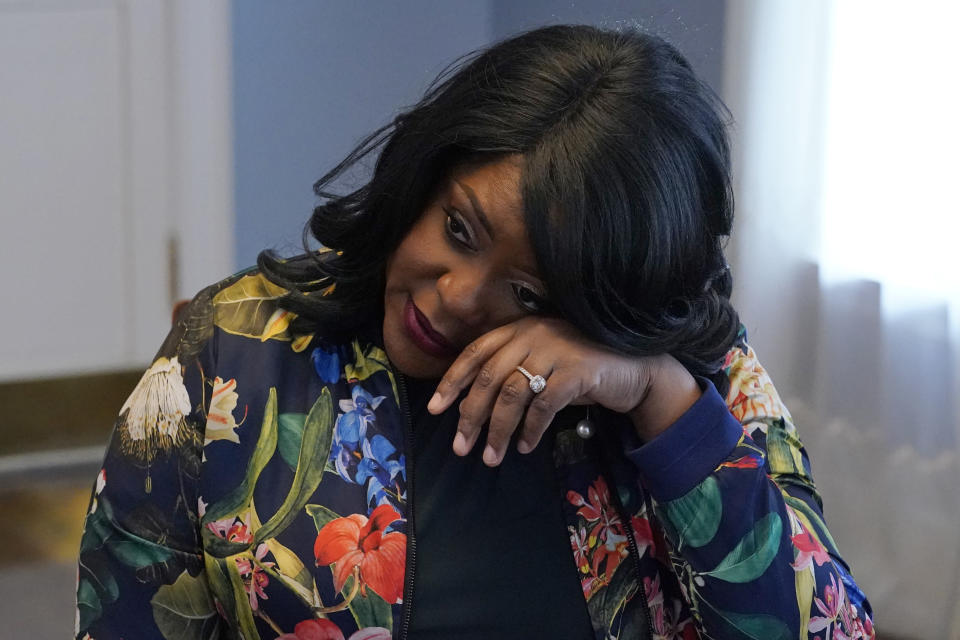 """Tiffany Crutcher wipes tears from her eyes during an interview in Tulsa, Okla., Monday, April 12, 2021. In 2016, Tulsa police officer Betty Shelby shot and killed Crutcher's twin brother, Terence Crutcher. Shelby, who is white, was acquitted of manslaughter. """"I believe that my brother's killing really unearthed a century of racial tension here in Tulsa,"""" said Crutcher. (AP Photo/Sue Ogrocki)"""