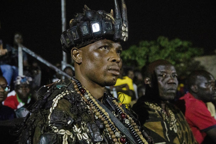 """Dozos, ancient hunters who have been drawn into the Islamic extremist fight, participate in a celebration of their culture in Bobo-Dioulasso, Burkina Faso, 360 kilometers (220 miles) west of the capital, Ouagadougou, on Sunday, March 28, 2021. """"Before someone faces a challenge, they know there are supernatural powers and spirits they can call upon in any situation,"""" said Jean Celestin Ky, professor of history at Joseph Ki-Zerbo University in Ouagadougou. (AP Photo/Sophie Garcia)"""