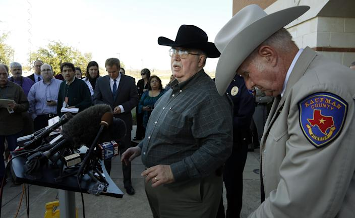 David Byrnes, Sheriff of Kaufman County, right, bows his head as Mike McLelland, District Attorney of Kaufman County answers questions at a news conference at the Kaufman Law Enforcement Center on Thursday, January 31, 2013, in Kaufman, Texas. Kaufman County Assistant District Attorney Mark Hasse was shot and killed early Thursday morning as he was walking from his car to the courthouse. (AP Photo/The Dallas Morning News, David Woo)