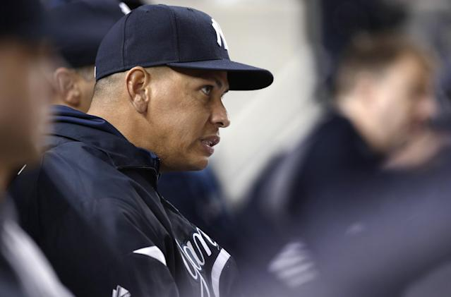 New York Yankees' Alex Rodriguez grimaces as he watches a play during the Yankees' baseball game against the Tampa Bay Rays, Thursday, Sept. 26, 2013, in New York. (AP Photo/Kathy Willens)