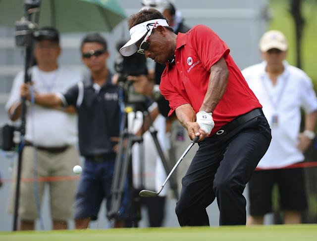 Thongchai Jaidee of Thailand hits a shot from the rough on the fourteenth hole during the third round of the Eurasia Cup golf tournament at the Glenmarie Golf and Country Club in Subang, Malaysia, Thursday, March 29, 2014