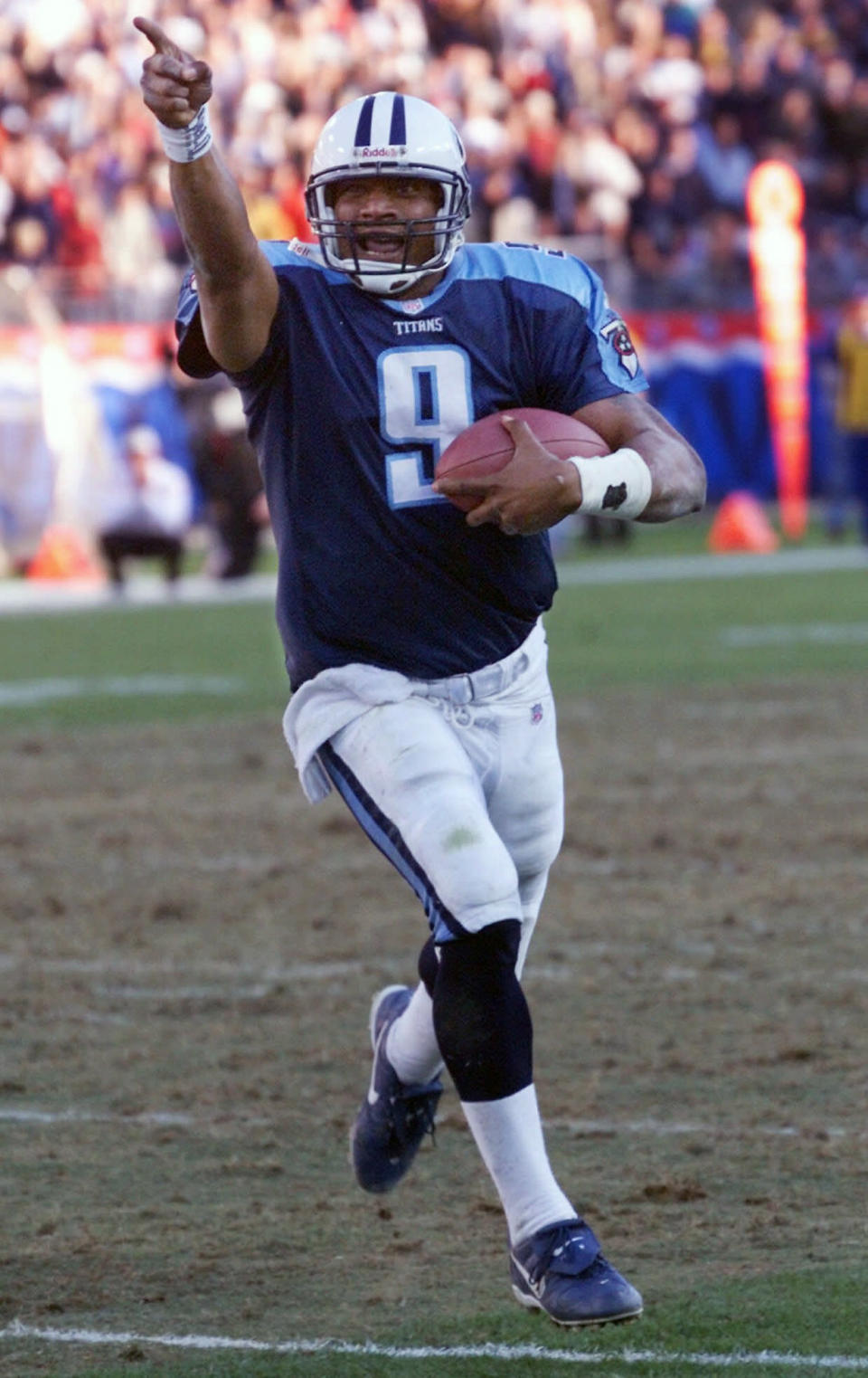 FILE - In this Dec. 19, 1999, file photo, Tennessee Titans quarterback Steve McNair points to the stands as he crosses the goal line for a fourth-quarter 3-yard touchdown during the Titans' 30-17 win over the Atlanta Falcons in Nashville, Tenn. The Tennessee Titans retiring Eddie George's No. 27 and the No. 9 of the late Steve McNair has turned from a simple halftime ceremony into a celebration and team reunion. (AP Photo/John Russell, FIle)