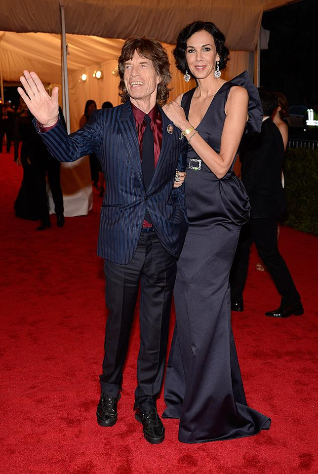 "<p class=""MsoNormal"">Rocker Mick Jagger, 68, greeted the crowd with his main squeeze, 45-year-old statuesque designer L'Wrenn Scott, who looked stunning as always. With a beauty like that on his arm, no wonder Mick looks so happy! </p>"