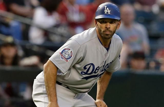 Texas Rangers reportedly hire Dodgers third-base coach Chris Woodward as new manager. (AP)