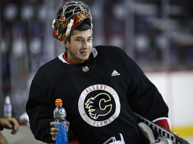 Calgary Flames goalie David Rittich, of the Czech Republic, takes break during NHL hockey training camp in Calgary, Friday, Sept. 13, 2019. (Jeff McIntosh/The Canadian Press via AP)