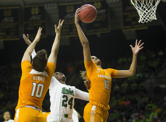 Tennessee's Rae Burrell (12) grabs a rebound as Notre Dame's Destinee Walker (24) fights for it with Tennessee's Jessie Rennie (10) during an NCAA college basketball game Monday, Nov. 11, 2019 at Purcell Pavilion in South Bend, Ind. (Michael Caterina/South Bend Tribune via AP)