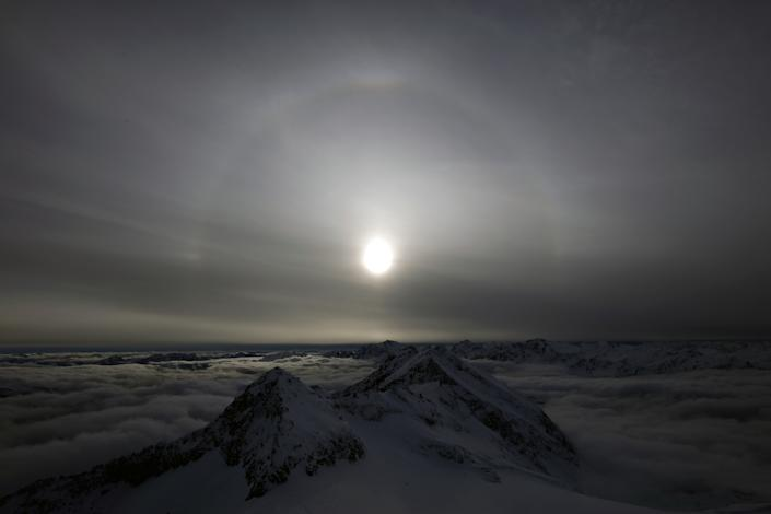 A halo, an optical phenomena from sunlight and ice crystals, rises above Goldberg group mountains, seen from Sonnblick summit at 3,106 meters above sea level, in the Hohe Tauern mountain range near Rauris, Austria. (Photo: Lisi Niesner/Reuters)