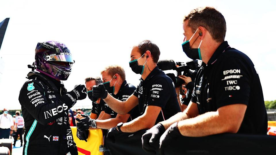 <p>Pole position qualifier Lewis Hamilton of Great Britain and Mercedes GP celebrates in parc ferme during qualifying for the F1 Grand Prix of Great Britain at Silverstone on August 01, 2020 in Northampton, England.</p>