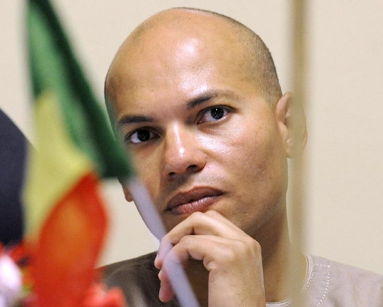 Karim Wade while visiting a phosphate mine and factory in Mboro, Senegal on April 30, 2008 (AFP Photo/Georges Gobet)