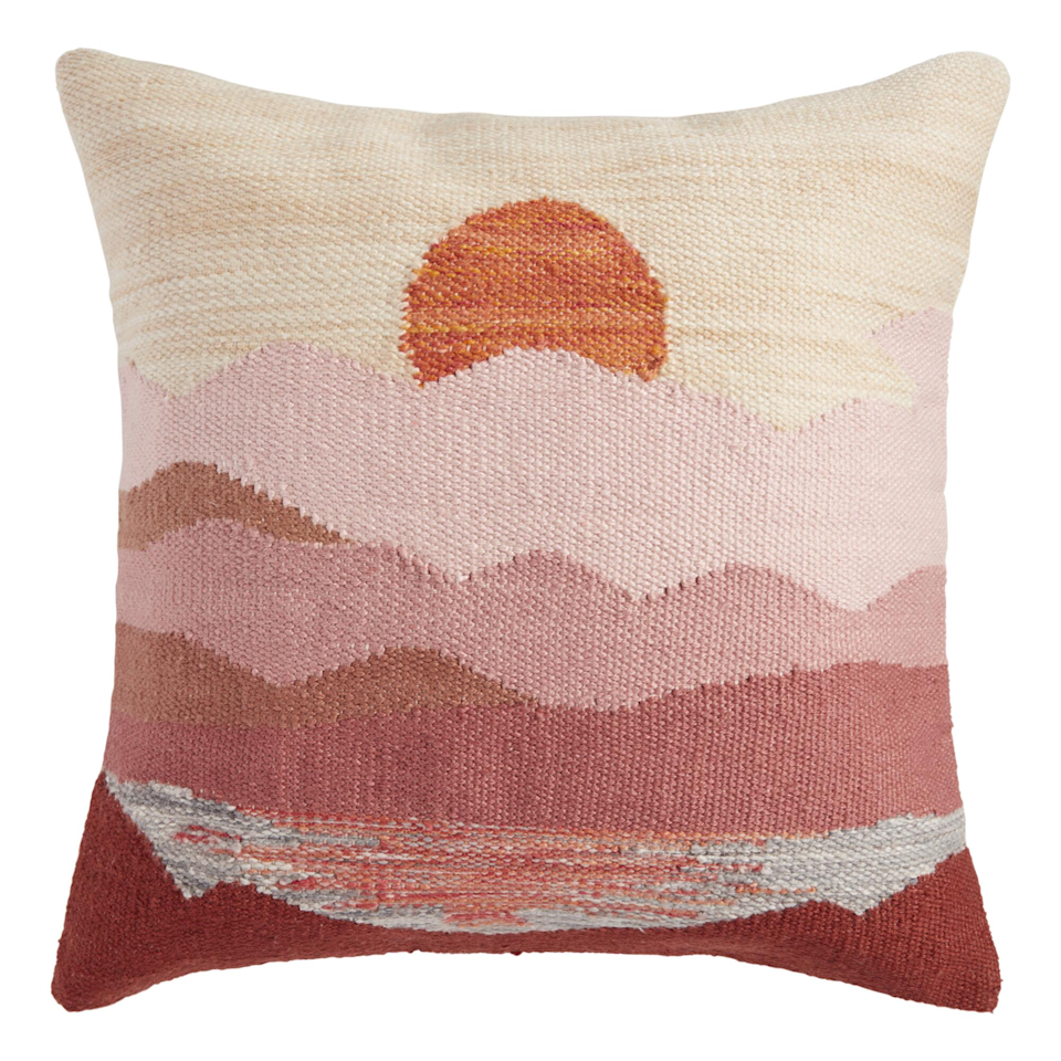 """So maybe a beach vacation isn't in the cards for you this summer. Pop this little baby in your living room for your own sherbet-colored sunset night after night. We give this pick bonus points for being consciously crafted and made out of recycled water bottles. <br><br><strong>Cost Plus World Market</strong> Warm Sunset Indoor Outdoor Throw Pillow, $, available at <a href=""""https://go.skimresources.com/?id=30283X879131&url=https%3A%2F%2Fwww.worldmarket.com%2Fproduct%2Fwarm%2Bsunset%2Bindoor%2Boutdoor%2Bthrow%2Bpillow.do"""" rel=""""nofollow noopener"""" target=""""_blank"""" data-ylk=""""slk:Cost Plus World Market"""" class=""""link rapid-noclick-resp"""">Cost Plus World Market</a>"""