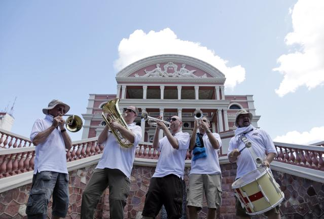 Members of the England Band from Sheffield, England, play in front of the Manaus Opera House during the 2014 soccer World Cup in Manaus, Brazil, Friday, June 13, 2014. Band members claim they have played in venues hosting England for the past 5 World Cups. This year, they will not be allowed to bring their instruments into the stadiums. England faces Italy in Manaus on June 14th. (AP Photo/Marcio Jose Sanchez)