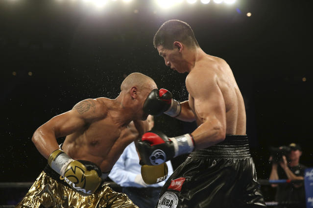 Dmitry Bivol, right, of Russia, hits Isaac Chilemba, of Malawi, during the 12th round of their light heavyweight bout Saturday, Aug. 4, 2018, in Atlantic City, N.J. Bivol won by unanimous decision. (AP Photo/Mel Evans)