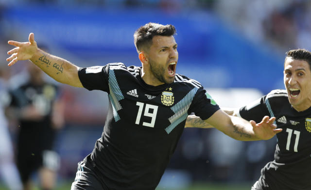 <p>Argentina's Sergio Aguero celebrates after scoring his side's first goal (AP) </p>