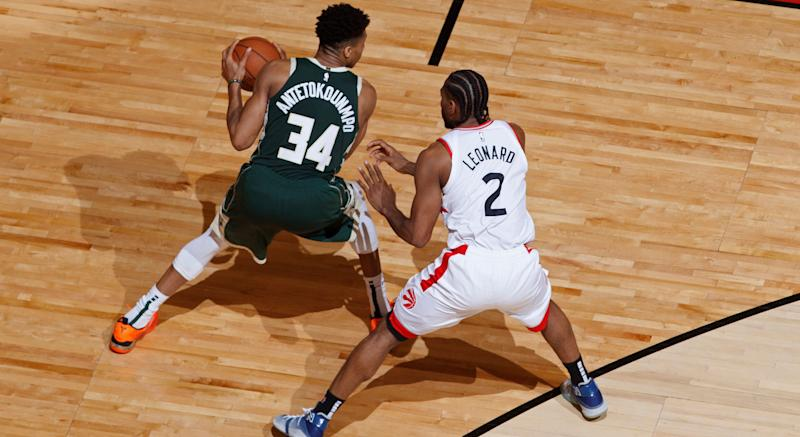 Milwaukee's Giannis Antetokounmpo handles the ball against Toronto's Kawhi Leonard during Eastern Conference Finals action at Scotiabank Arena. (Photo by Mark Blinch/NBAE via Getty Images)